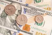 American Coins On One Hundred Dollars Banknotes.