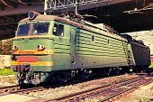 Green Modern Russian Locomotive With Red Stripes On Cabin