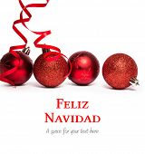 Feliz navidad against four red christmas ball decorations