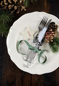 Traditional Christmas Holiday Table Place Setting With Fine China On Dark Recycled Wood Background.