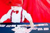 Little Beautiful Child Plays Cards