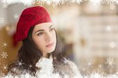 Portrait of a pretty brunette in day dreaming against fir tree forest and snowflakes