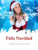 sexy santa girl blowing over hands against feliz navidad