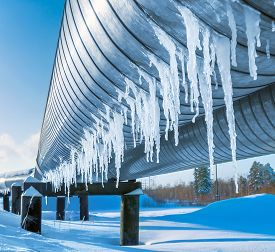 stock photo of gas-pipes  - Gas pipe in the winter with hanging icicles - JPG