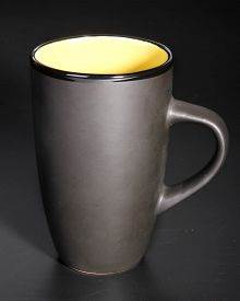 stock photo of loamy  - Photo of the Black mug over black background - JPG