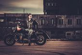 foto of ape-man  - Biker and his bobber style motorcycle on a city streets  - JPG