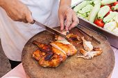 picture of chef knife  - Chef are using Kitchen knife chicken grilled on wood block  - JPG