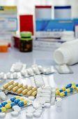 pic of paracetamol  - A pile of medicine or drug on table  - JPG