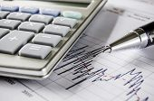 picture of calculator  - Stock exchange graph with calculator and pen - JPG