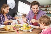 image of 11 year old  - Family Eating Meal In Kitchen Together - JPG