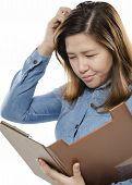 stock photo of scratching head  - A Business woman scratching head while thinking - JPG