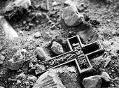 stock photo of jesus  - black and white cross lying on the ground - JPG