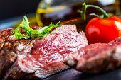 stock photo of porterhouse steak  - Grilled Beef steak with vegetable decoration - JPG