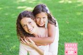 stock photo of happy day  - mothers day greeting against happy mother and daughter smiling at camera - JPG