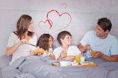 foto of bed breakfast  - Family having breakfast in bed against heart - JPG