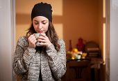 pic of hot-weather  - Portrait of a gorgeous young brunette woman relaxing with mug of hot beverage - JPG