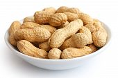 pic of ceramic bowl  - Round ceramic bowl of peanuts in shells - JPG