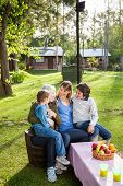 picture of multi-generation  - Happy multi generation family on chairs at campsite - JPG