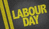 picture of labourer  - Labour Day written on the road - JPG