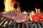 image of bloody  - Raw Fresh Bloody Strip Steak Tomatoes And Mushrooms On Hot Grill - JPG