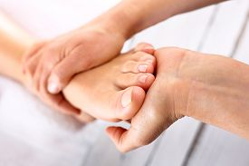 pic of foot  - Woman in a beauty salon for pedicure and foot massage - JPG