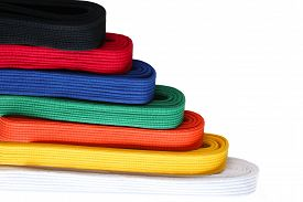 stock photo of taekwondo  - Seven colors of martial arts Taekwondo belts in order from low to high - JPG