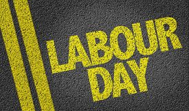 stock photo of labourer  - Labour Day written on the road - JPG