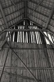 image of gable-roof  - Interior view of a big old barn with a view at the gable and the roof in partially half - JPG
