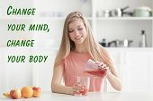 Weight loss motivation concept. Young woman pouring fresh juice at kitchen. Text CHANGE YOUR BODY, C poster
