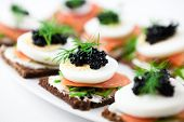 foto of canapes  - Canapes with smoked salmon and caviar - JPG