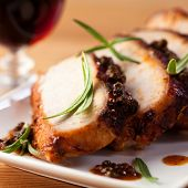stock photo of pork cutlet  - Roast pork with green peppercorns - JPG