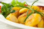 stock photo of baked potato  - Baked potatoes with rosemary - JPG
