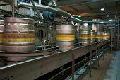 stock photo of century plant  - Beer kegs on the production line in the factory - JPG