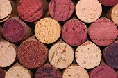 Wine corks lined up in a pattern