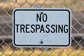 No Trespassing Sign Black Text Chain Link Fence