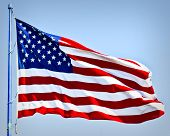 image of american flags  - an american flag boldly flying in the wind - JPG