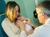 Medical examination of a little child at a ear nose throat doctor