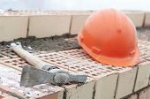 Construction equipment for brick building work helmet trowel and pecker