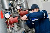 stock photo of manometer  - maintenance engineer checking technical data of heating system equipment in a boiler room - JPG