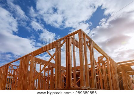 poster of Close-up Of Beam Built Home Under Construction And Blue Sky With Wooden Truss, Post And Beam Framewo