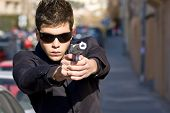 Agent aiming with gun in the middle of the street