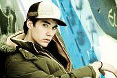 Young man portrait under urban background