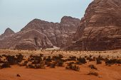 Red Mountains Of The Canyon Of Wadi Rum Desert In Jordan. Wadi Rum Also Known As The Valley Of The M poster