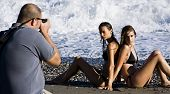 Photographer and models in summer photoshooting