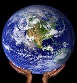 Hands holding the earth. Earth image courtesy NASA via public domain images.