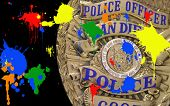 Police Officer Badge And Paint Graffiti Splatters portray civil disobedience