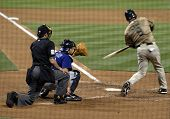 Jose Cruz Jr. of the San Diego Padres drives the ball during a game versus the Colorado Rockies at P
