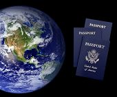 Worldwide travel and tourism - United States passports. Earth image courtesy NASA via public domain.