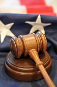 Gavel of Freedom - American flag background and judicial symbols