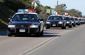 SAN DIEGO, CA - OCTOBER 29, 2008: Fort Rosecrans National Cemetery. A long line of police cars move